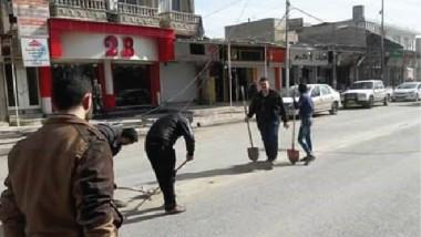 داعش يحتكر المواد الغذائية ويفاقم معاناة الأهالي في أيمن الموصل