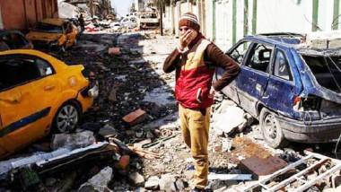 """الموصليون المحاصرون يبتكرون """"خططاً يائسة"""" لضمان الخلاص أمواتاً أو أحياءً"""