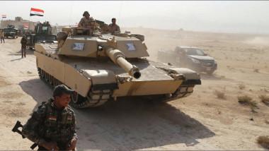 القوّات المشتركة تقترب من مركز عنه  وعناصر داعش ينسحبون إلى حي الشيشان