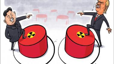 التهديد بالزر النووي عن موقع «كارتون سياسي»