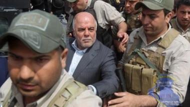 العبادي يفتح تحقيقاً مع حمايته في الاعتداء على صحفيين في النجف
